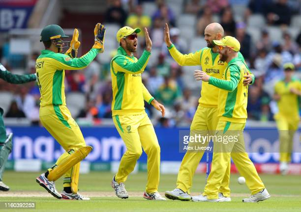 Nathan Lyon of Australia celebrates with Alex Carey after taking the wicket of Aiden Markram of South Africa during the Group Stage match of the ICC...