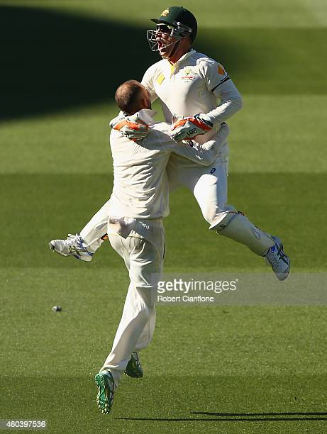 Nathan Lyon of Australia celebrates with Brad Haddin after taking the wicket of Ishant Sharma of India to give Australia victory during day five of...