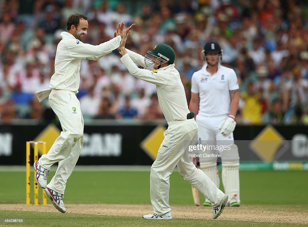 Nathan Lyon of Australia celebrates with George Bailey after he took the wicket of Joe Root of England during day four of the Second Ashes Test Match between Australia and England at Adelaide Oval on December 8, 2013 in Adelaide, Australia.