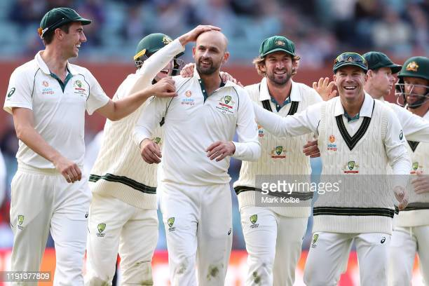 Nathan Lyon of Australia celebrates with his team mates after taking the wicket of Shaheen Shah Afridi of Pakistan during day four of the Second Test...