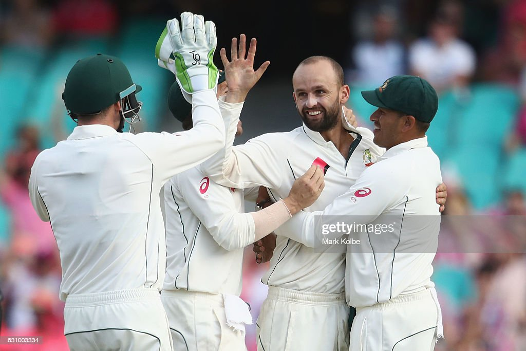 Nathan Lyon of Australia celebrates with his team mates after taking the wicket of Wahab Riaz of Pakistan during day three of the Third Test match between Australia and Pakistan at Sydney Cricket Ground on January 5, 2017 in Sydney, Australia.