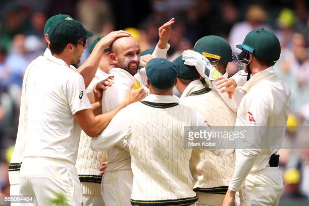 Nathan Lyon of Australia celebrates with his team mates after taking the wicket of Alastair Cook of England during day three of the Second Test match...