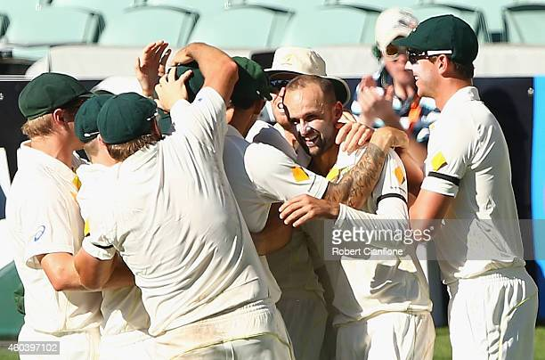 Nathan Lyon of Australia celebrates with his teammates after taking the wicket of Virat Kohli of India during day five of the First Test match...