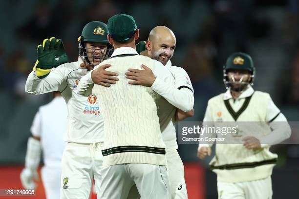 Nathan Lyon of Australia celebrates with Josh Hazlewood of Australia after the run-out of Virat Kohli of India during day one of the First Test match...