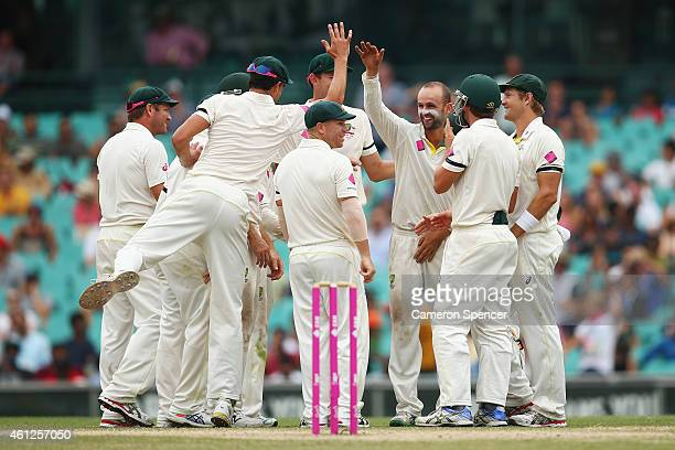 Nathan Lyon of Australia celebrates with team mates after dismissing Wriddhiman Saha of India during day five of the Fourth Test match between...