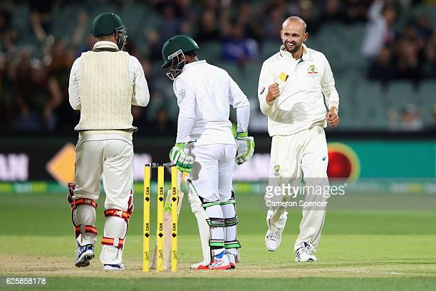 Nathan Lyon of Australia celebrates with team mates after dismissing Temba Bavuma of South Africa during day three of the Third Test match between...