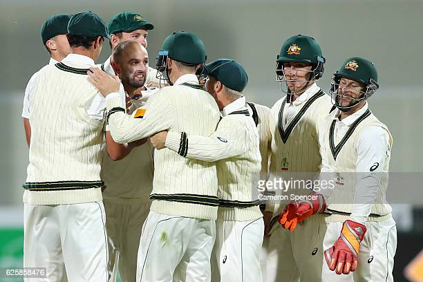 Nathan Lyon of Australia celebrates with team mates after dismissing Kyle Abbott of South Africa during day three of the Third Test match between...