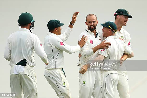 Nathan Lyon of Australia celebrates with team mates after dismissing Sharjeel Khan of Pakistan during day four of the Third Test match between...