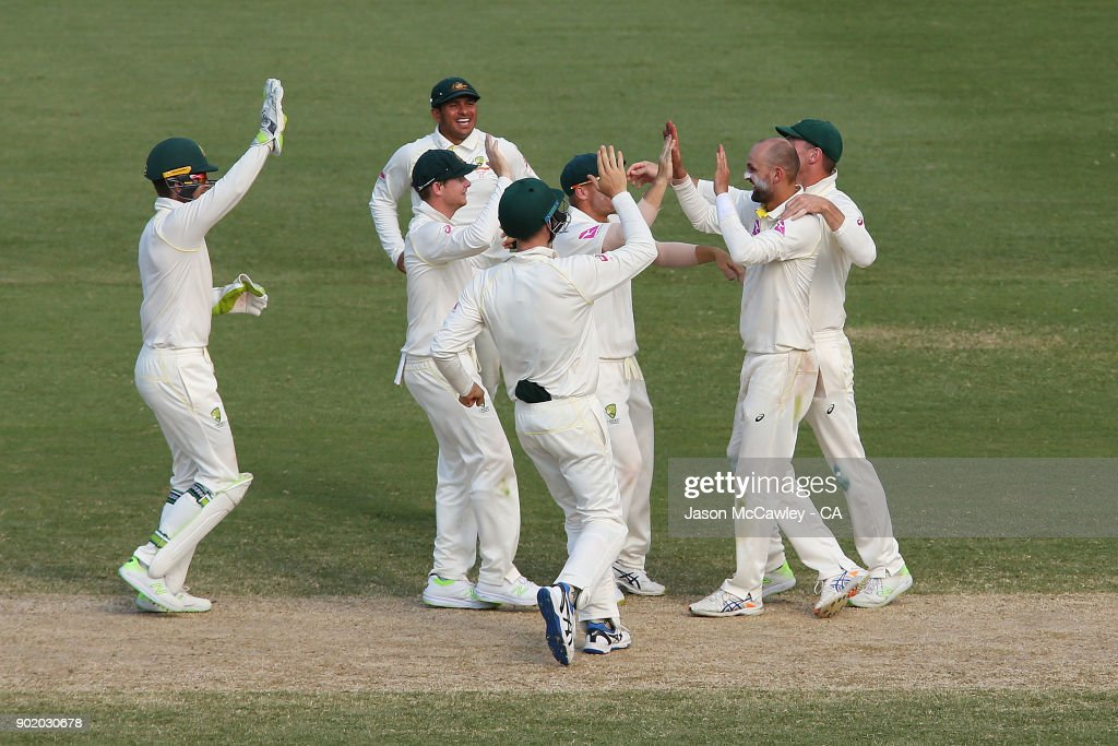 Nathan Lyon of Australia celebrates with team mates after dismissing Dawid Malan of England during day four of the Fifth Test match in the 2017/18 Ashes Series between Australia and England at Sydney Cricket Ground on January 7, 2018 in Sydney, Australia.