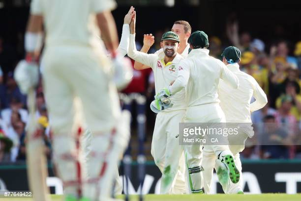 Nathan Lyon of Australia celebrates with team mates after running out James Vince of England during day one of the First Test Match of the 2017/18...