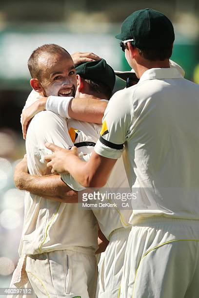Nathan Lyon of Australia celebrates with teammates after he got the wicket of Virat Kohli of India during day five of the First Test match between...