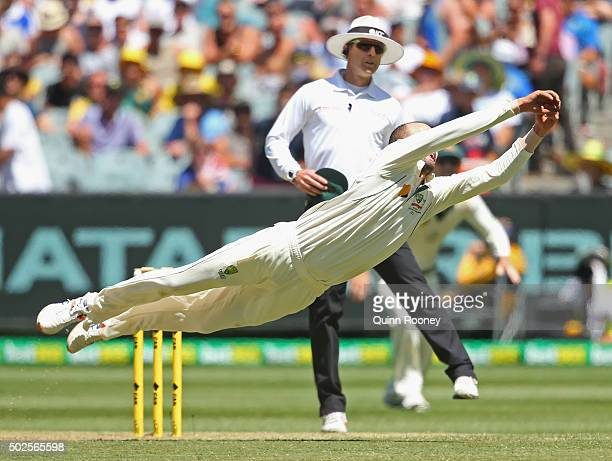Nathan Lyon of Australia dives for a catch during day two of the Second Test match between Australia and the West Indies at Melbourne Cricket Ground...