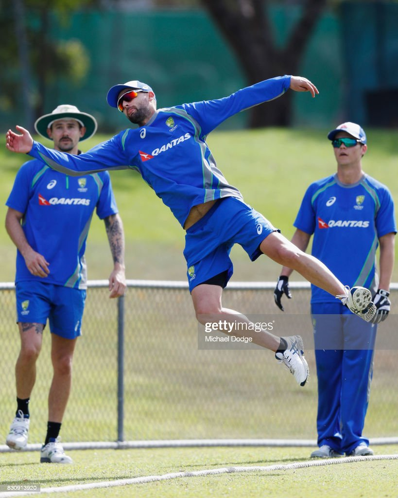 Nathan Lyon of Australia dives for an attempted catch during an Australia Test cricket squad training session at Marrara Cricket Ground on August 13, 2017 in Darwin, Australia.
