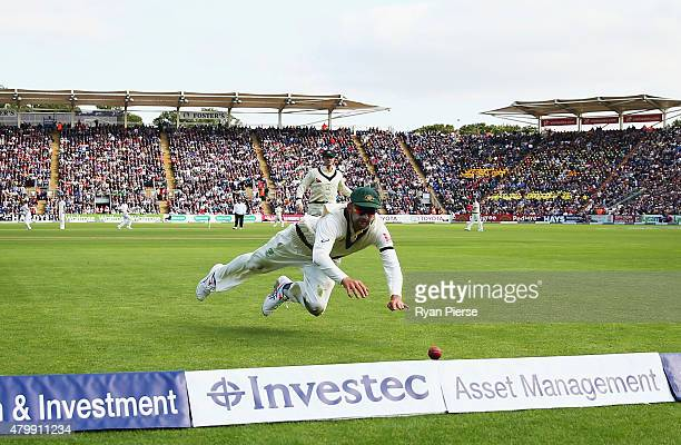 Nathan Lyon of Australia dives to field the ball during day one of the 1st Investec Ashes Test match between England and Australia at SWALEC Stadium...