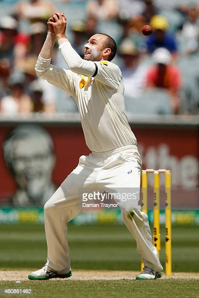 Nathan Lyon of Australia drops a catch during day three of the Third Test match between Australia and India at Melbourne Cricket Ground on December...