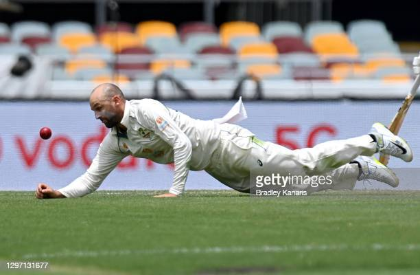 Nathan Lyon of Australia fields the ball during day five of the 4th Test Match in the series between Australia and India at The Gabba on January 19,...