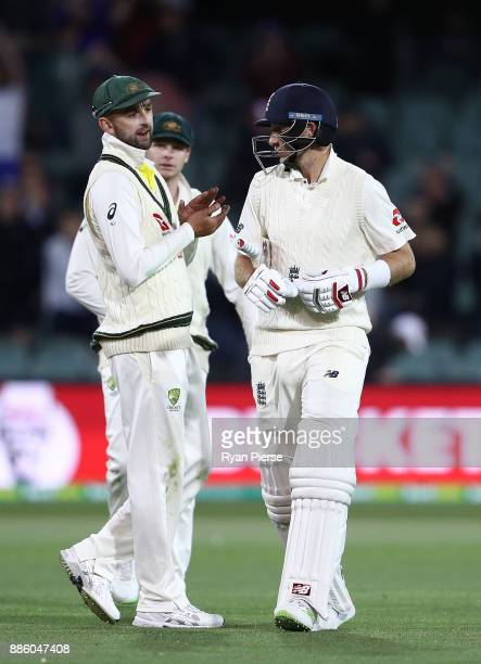 Nathan Lyon of Australia has words with Joe Root of England at stumps during day four of the Second Test match during the 2017/18 Ashes Series...