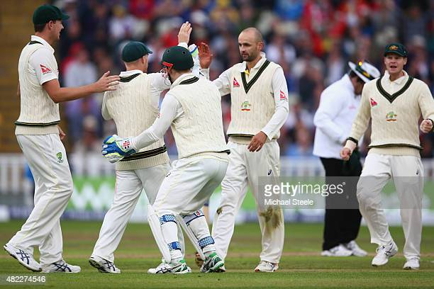 Nathan Lyon of Australia high fives David Warner after capturing the wicket of Ian Bell during day one of the 3rd Investec Ashes Test match between...