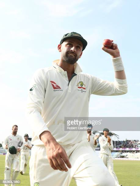 Nathan Lyon of Australia holds up the ball after he took 13 wickets for the match during day four of the Second Test match between Bangladesh and...