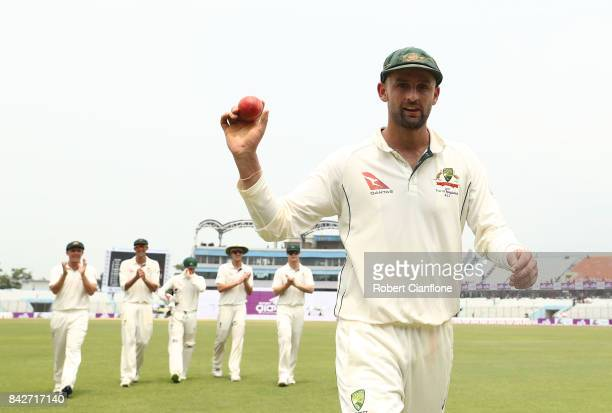 Nathan Lyon of Australia holds up the ball after he took seven wickets in the first innings during day two of the Second Test match between...