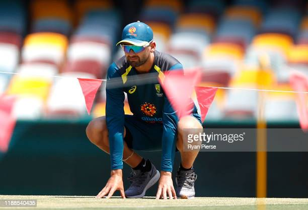 Nathan Lyon of Australia inspects the pitch during an Australia nets session at The Gabba on November 19, 2019 in Brisbane, Australia.