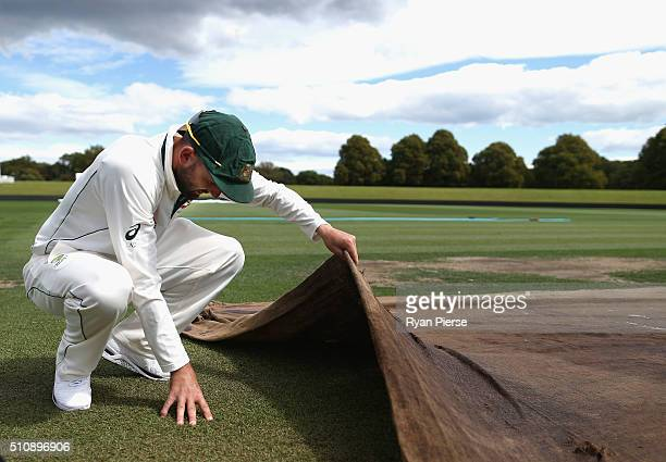 Nathan Lyon of Australia inspects the pitch during an Australia nets session at Hagley Oval on February 18 2016 in Christchurch New Zealand