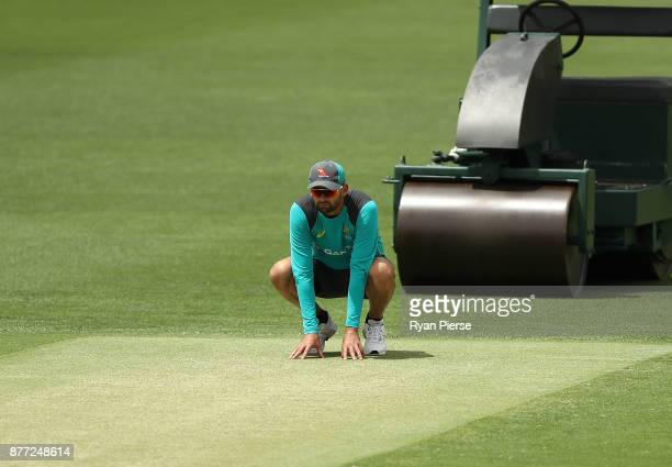 Nathan Lyon of Australia inspects the pitch during an Australian nets session at The Gabba on November 22 2017 in Brisbane Australia