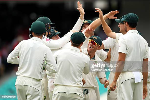 Nathan Lyon of Australia is congratulated by David Warner and team mates after dismissing MisbahulHaq of Pakistan during day three of the Third Test...