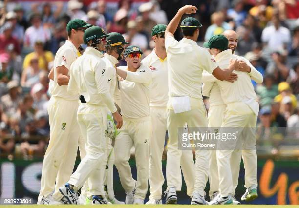 Nathan Lyon of Australia is congratulated by team mates after getting the wicket of Joe Root of England during day four of the Third Test match...