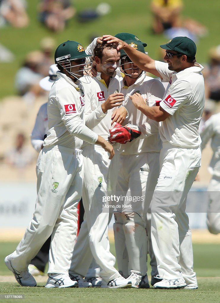 Nathan Lyon (C) of Australia is congratulated by team mates after he got the wicket of Virender Sehwag during day four of the Fourth Test Match between Australia and India at Adelaide Oval on January 27, 2012 in Adelaide, Australia.