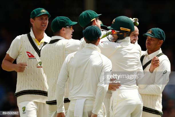 Nathan Lyon of Australia is congratulated by team mates after dismissing Moeen Ali of England during day five of the Third Test match during the...