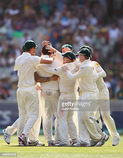 Nathan Lyon of Australia is congratulated by team mates after taking his 100th test wicket that of Stuart Broad of England during day three of the...
