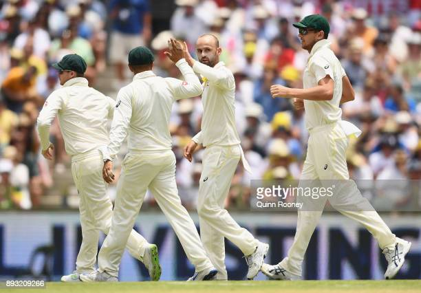 Nathan Lyon of Australia is congratulated by team mates after taking the wicket of Dawid Malan of England during day two of the Third Test match...