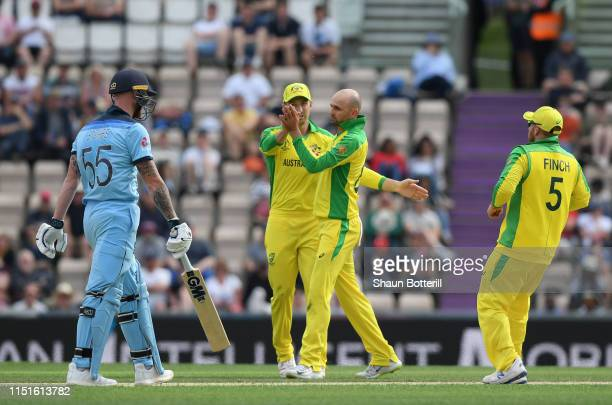 Nathan Lyon of Australia is congratulated by teammates after taking the wicket of Ben Stokes of England during the ICC Cricket World Cup 2019 Warm Up...
