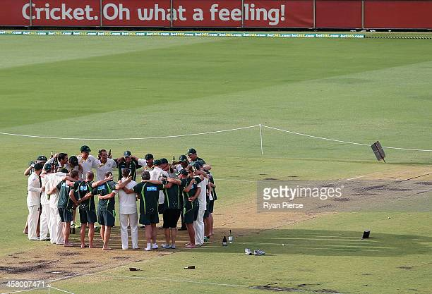 Nathan Lyon of Australia leads the team song on the pitch after day five of the Third Ashes Test Match between Australia and England at WACA on...
