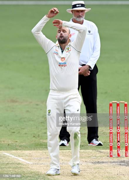 Nathan Lyon of Australia looks frustrated during day five of the 4th Test Match in the series between Australia and India at The Gabba on January 19,...