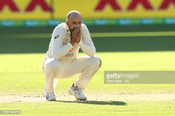Nathan Lyon of Australia looks on during day five of the 4th Test Match in the series between Australia and India at The Gabba on January 19, 2021 in...