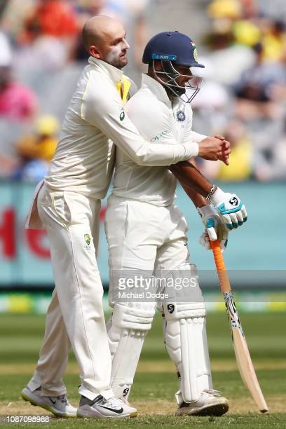 Nathan Lyon of Australia playfully puts a bear hug on Rishabh Pant of India after Rohit Sharma of India played a stroke during day two of the Third...