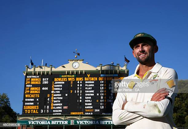 Nathan Lyon of Australia poses in front of the scoreboard after taking seven wickets in the second innings and 12 wickets for the match after day...