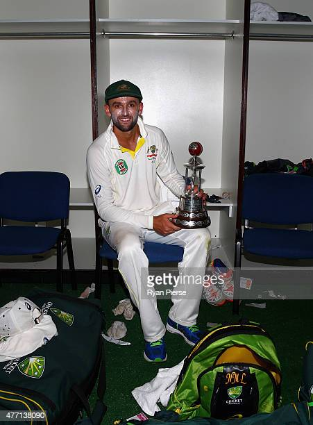 Nathan Lyon of Australia poses with the Frank Worrell Trophy in the change rooms after day four of the Second Test match between Australia and the...