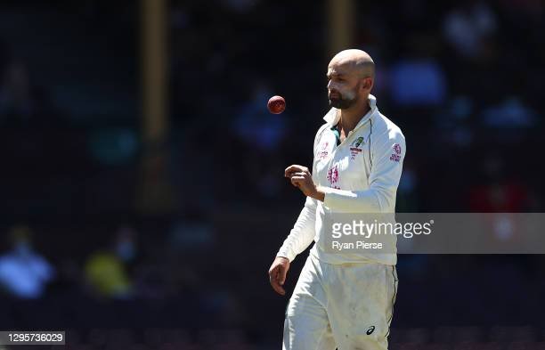 Nathan Lyon of Australia prepares to bowl during day five of the 3rd Test match in the series between Australia and India at Sydney Cricket Ground on...