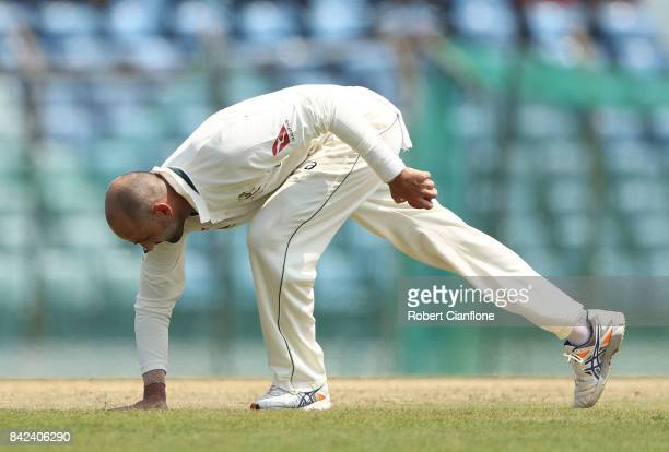 Nathan Lyon of Australia prepares to bowl during day one of the Second Test match between Bangladesh and Australia at Zahur Ahmed Chowdhury Stadium...