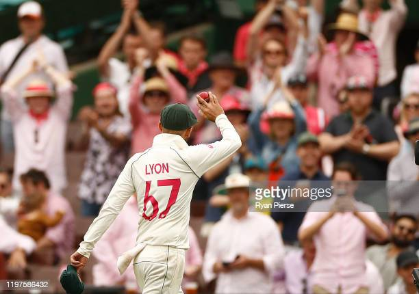 Nathan Lyon of Australia raises the ball aloft after claiming his fifth wicket of the innings during day three of the Third Test match in the series...