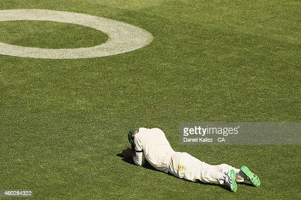Nathan Lyon of Australia reacts after appeals dropped catch during day three of the First Test match between Australia and India at Adelaide Oval on...