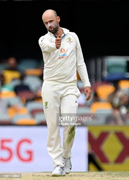 Nathan Lyon of Australia reacts after bowling a ball during day five of the 4th Test Match in the series between Australia and India at The Gabba on...