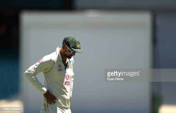 Nathan Lyon of Australia reacts after bowling an over during day five of the 3rd Test match in the series between Australia and India at Sydney...