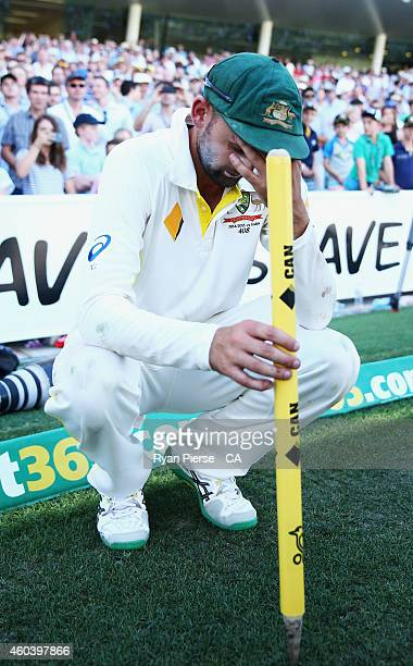 Nathan Lyon of Australia reacts after claiming victory during day five of the First Test match between Australia and India at Adelaide Oval on...