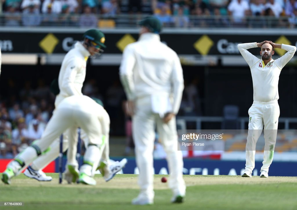 Nathan Lyon of Australia reacts after Tim Paine of Australia dropped James Vince of England edged during day one of the First Test Match of the 2017/18 Ashes Series between Australia and England at The Gabba on November 23, 2017 in Brisbane, Australia.