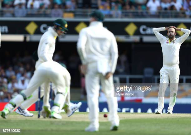 Nathan Lyon of Australia reacts after Tim Paine of Australia dropped James Vince of England edged during day one of the First Test Match of the...