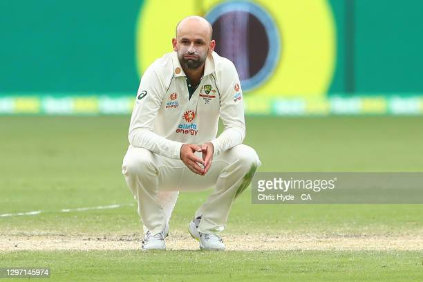 Nathan Lyon of Australia reactsduring day five of the 4th Test Match in the series between Australia and India at The Gabba on January 19, 2021 in...